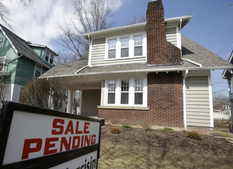 Contracts to buy homes slipped for the eighth straight month in February, but Realtors see a spring thaw.