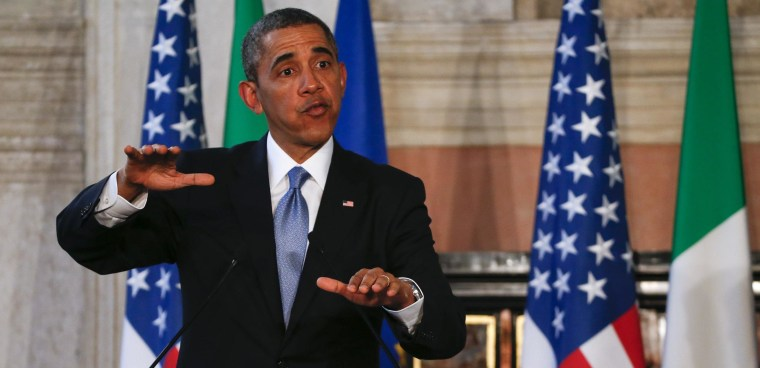 Image: U.S. President Obama gestures during a joint news conference with Italian Prime Minister Renzi at the end of a meeting at Villa Madama in Rome