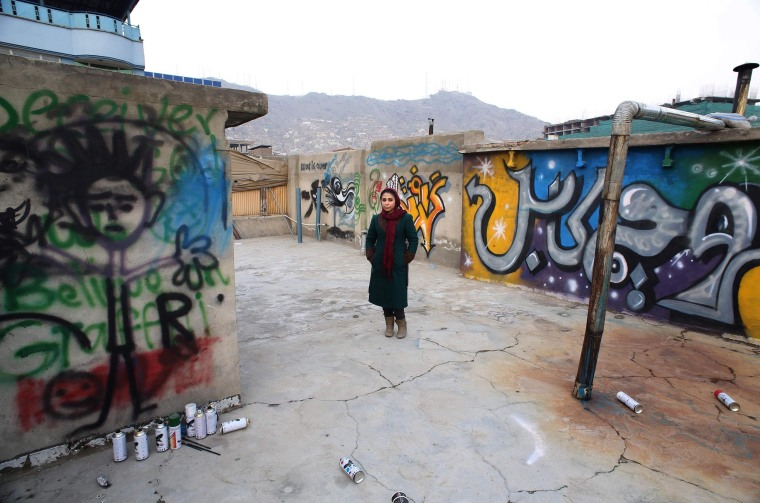 Image: Afghan artist Shamsia Hassani poses for a photograph on the roof of her graffiti workshop in Kabul