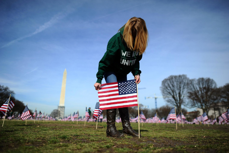 Image: A war veteran helps set up 1,892 American flags on the National Mall in Washington, D.C.