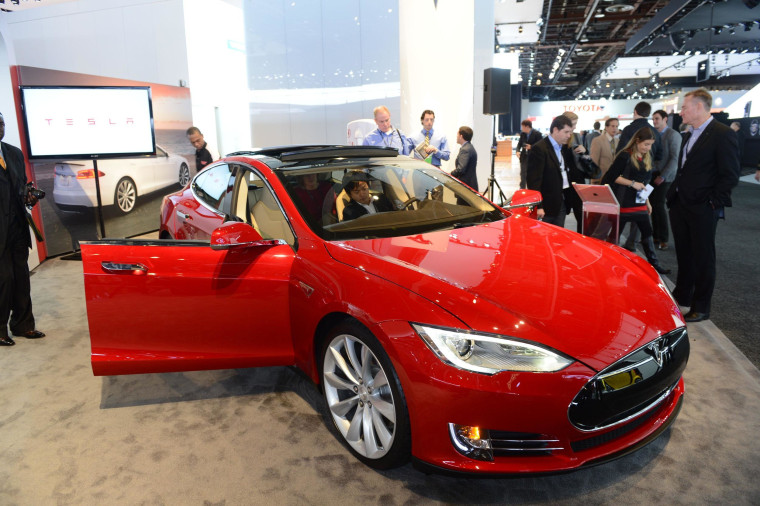 Road safety agency drops its probe of Tesla car fires as the electric automaker says it is adding a shield to protect the battery compartment.