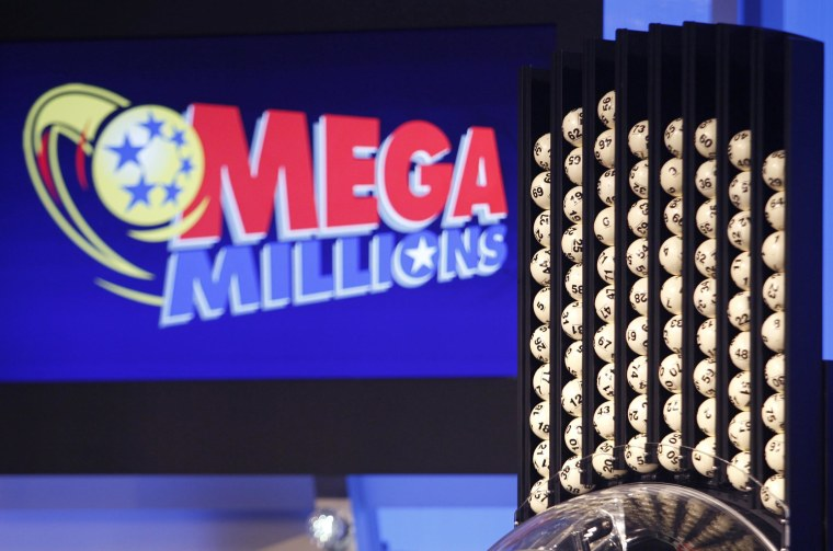 Lottery balls wait to be dropped prior to a Mega Millions lottery drawing.