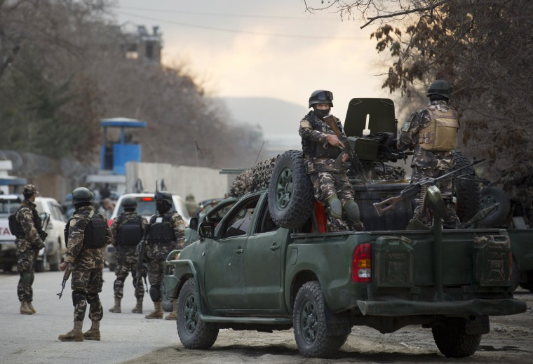 Image: Commandos with Afghanistan's intelligence agency arrive after four suicide bombers armed with assault rifles and hand grenades attacked a guesthouse in a southwestern neighborhood of Kabul