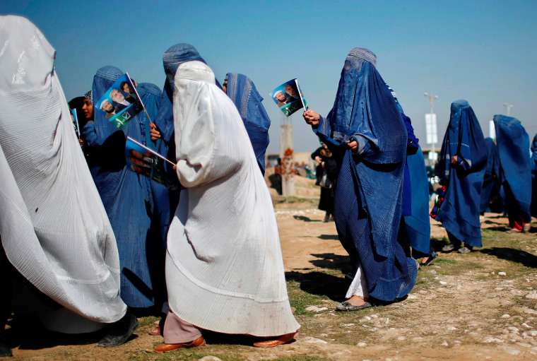 Image: Supporters of Afghan presidential candidate Abdullah arrive to attend an election rally in Mazar-I-Shariff
