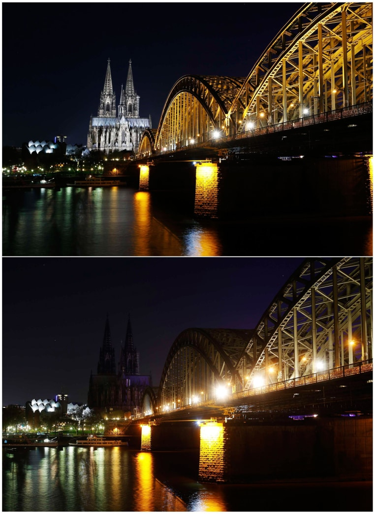 Image: The UNESCO World Heritage Cologne Cathedral and the Hohenzollern railway bridge along the river Rhine during and before Earth Hour