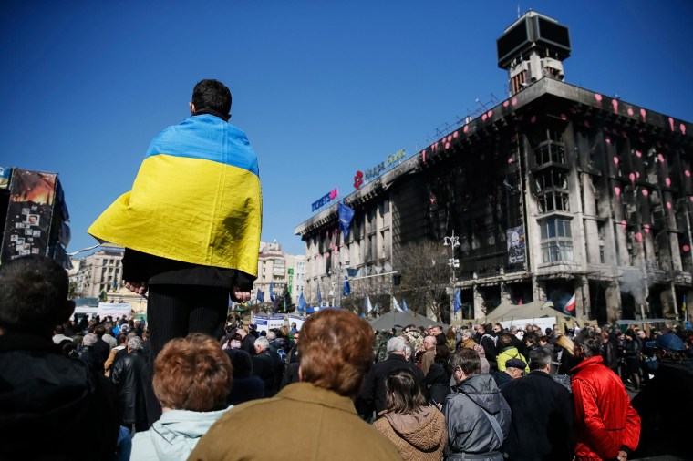 Image: People attend a religious service in Independence Square in Kiev