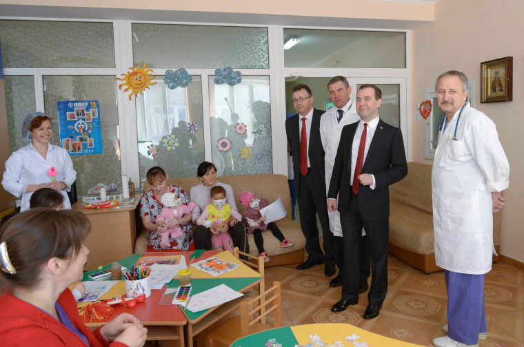 Image: Russia's Prime Minister Dmitry Medvedev visits a children's hospital in the Crimean city of Simferopol