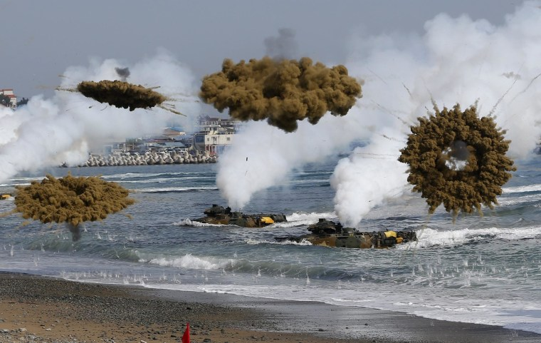 Image: Amphibious assault vehicles of the South Korean Marine Corps throw smoke bombs as they move to land on shore during a U.S.-South Korea joint landing operation drill in Pohang