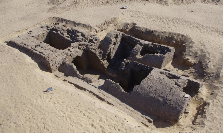 Dating back around 3,300 years, this tomb was discovered recently at an ancient cemetery at Abydos in Egypt. At left is a rectangular entrance shaft with massive walls that served as the base for a pyramid thought to have risen 23 feet (7 meters) in height.