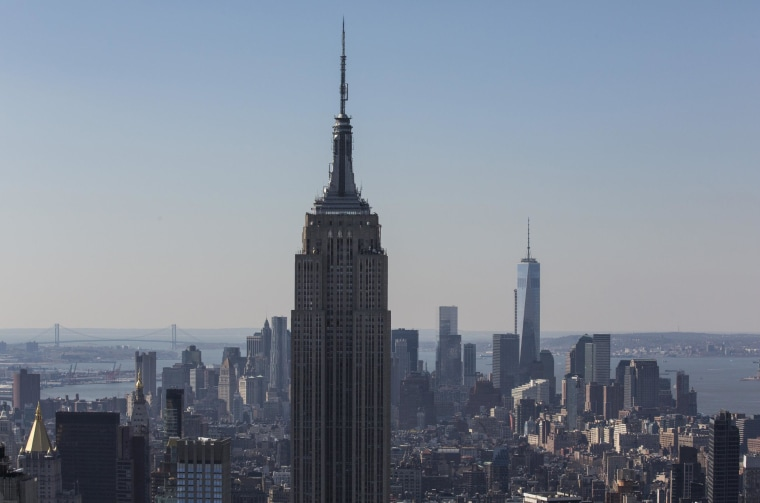 The Empire State Building, left, and One World Trade Center are seen from the top of Rockefeller Center on March 21 in New York City.