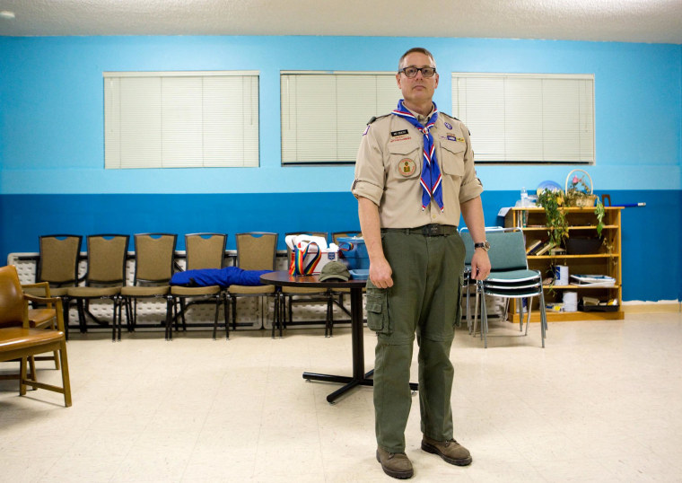 Scoutmaster Geoff McGrath poses for a portrait after a troop meeting at Rainier Beach United Methodist Church in Seattle, Wash., on March 27, 2014.