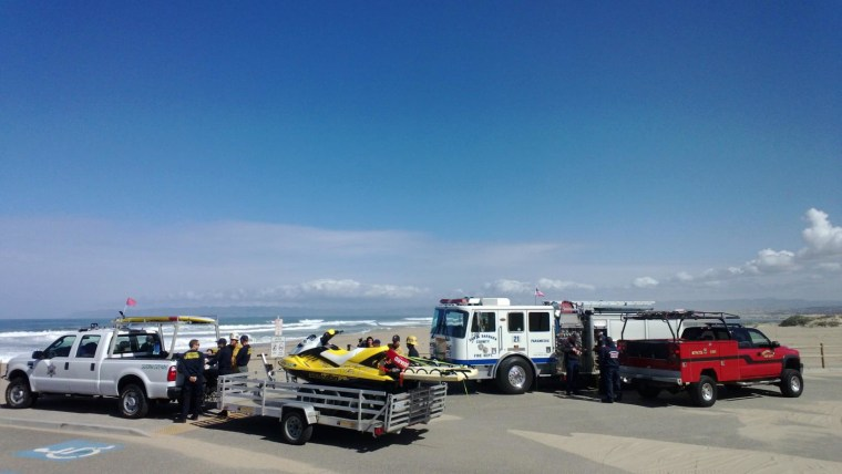 Rescue teams gather to search the Guadalupe Dunes Park on March 31, 2014 for a man who was pulled into the surf Sunday during a baptism ceremony.