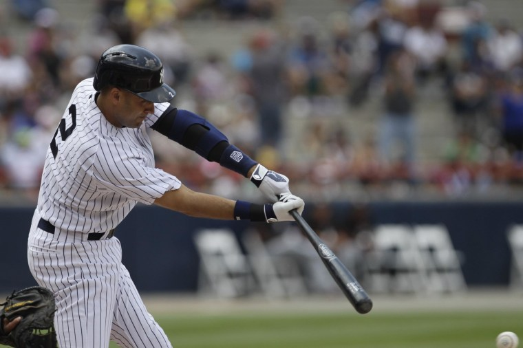 """Image: New York Yankees' Jeter bats against Miami Marlins during first inning of exhibition game """"Legend Series"""" honoring former New York Yankees player Mariano Rivera, at the Rod Carew Stadium in Panama City"""