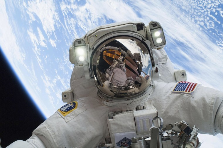 Image: Astronaut Mike Hopkins participates in a spacewalk.