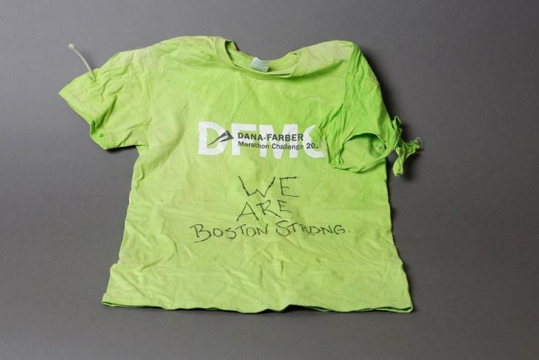 Image: A T-shirt, an artifact saved from the makeshift Boston Marathon bombing memorial