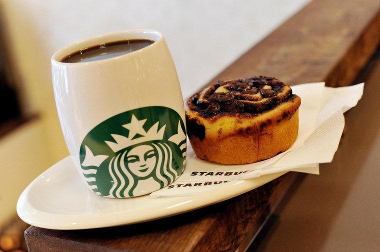 A Starbucks coffee and a Danish pastry.