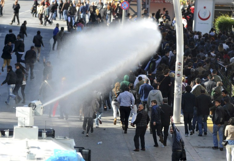 Image: Riot police use water cannons to disperse protesters outside the Supreme Electoral Council (YSK) in Ankara