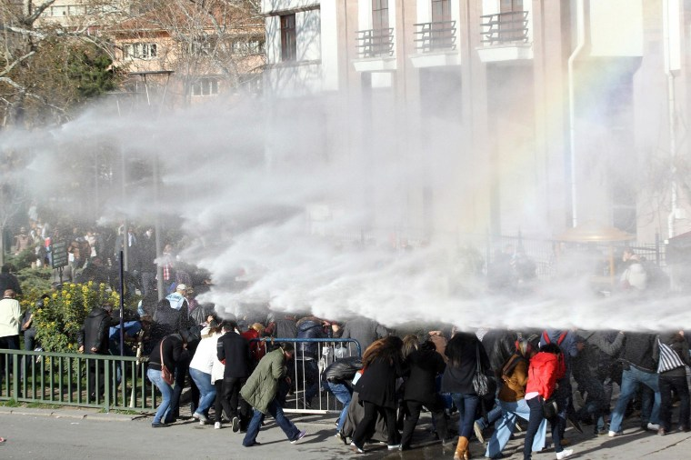 Image: Turkish riot police use water cannon to disperse protesters outside the Supreme Electoral Council (YSK) in Ankara