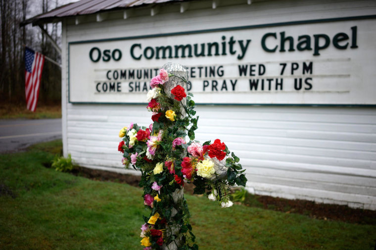 Image: A flower cross memorial is set up outside the Oso Community Chapel for mudslide victims in Oso