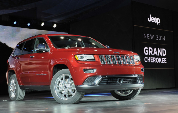 The 2014 Jeep Grand Cherokee is introduced at the North American International Auto Show in Detroit