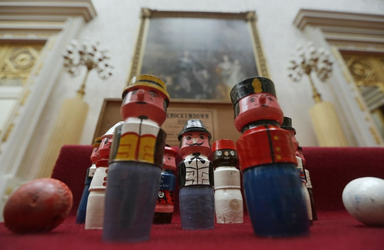 Image: A set of Knockemdown ninepins belonging to Britain's Queen Elizabeth are seen at Buckingham Palace in London