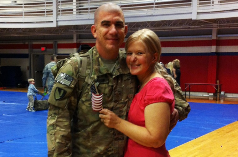 Army Maj. John Considine with his wife, Marily, on Feb. 4, the day he returned from Afghanistan to Fort Hood.