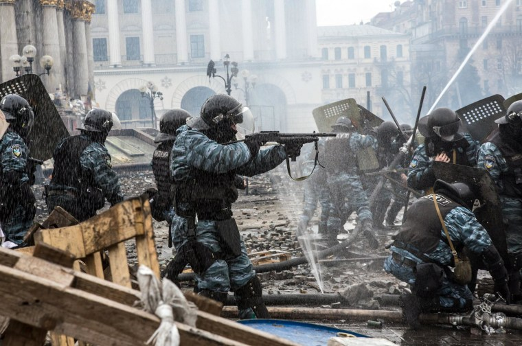 Berkut riot police shoot rubber bullets toward anti-government protesters on Independence Square on February 19, 2014 in Kiev, Ukraine. After several weeks of calm, violence has again flared between anti-government protesters and police as the Ukrainian parliament is meant to take up the question of whether to revert to the country's 2004 constitution.