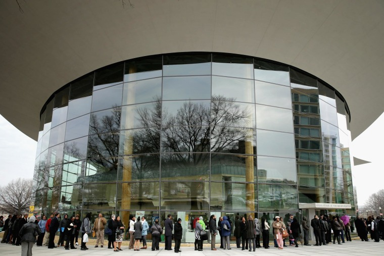 About 1,500 people seeking employment wait in line to enter a job fair outside the Arena Stage at the Mead Center for American Theater March 28, 2014 in Washington, DC.