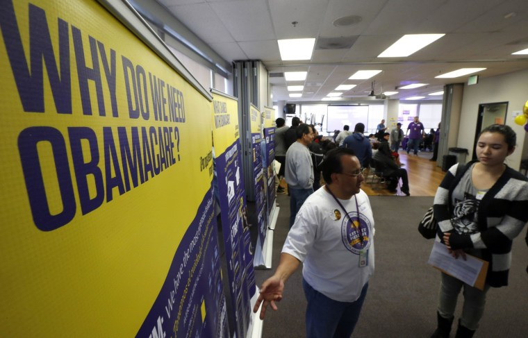 Julian Gomez explains Obamacare to people at a health insurance event in Commerce, Calif. on March 31, 2014. A group that sought to help enroll people for coverage found Latinos were as likely as whites to enroll after four contacts.