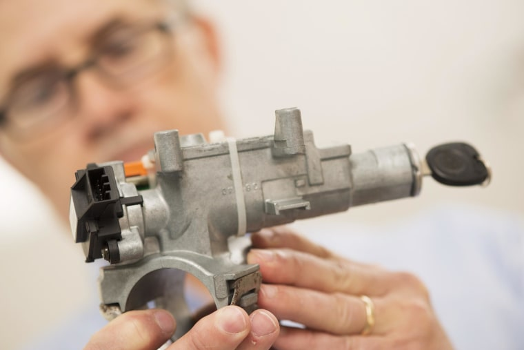 Image: Consulting materials engineer Mark Hood shows the ignition assembly in Pensacola