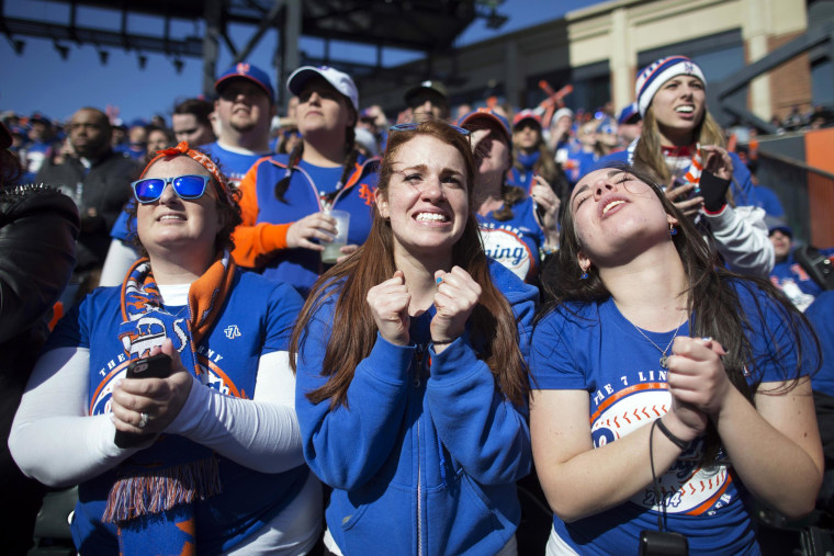 Image: New York Mets fans react during a baseball game against the Washington Nationals on opening day at Citi Field