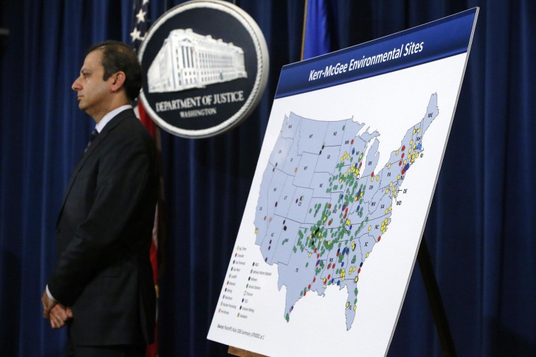Image: U.S. Attorney for the Southern District of New York Bharara stands beside a map during an announcement of a settlement with Anadarko Petroleum Corp in Washington