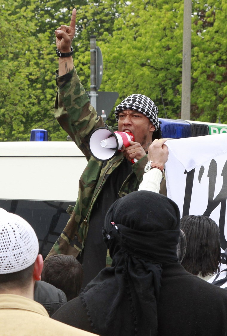 Rapper Deso Dogg, who converted to Islam in 2010, shouts into a megaphone during a rally in Bonn, Germany, in 2012.