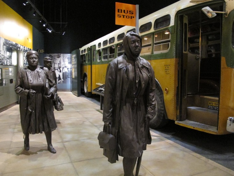 This March 19, 2014, photo shows statues of three women walking next to a replica of a city bus, part of an exhibit about Montgomery's bus boycotts at the newly renovated National Civil Rights Museum in Memphis, Tenn.