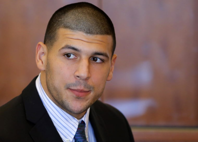 Aaron Hernandez, former player for the NFL's New England Patriots football team, attends a pre-trial hearing at the Bristol County Superior Court in Fall River, Massachusetts October 9, 2013, in connection with the death of semi-pro football player Odin Lloyd in June. Hernandez, who was a rising star in the NFL before his arrest and release by the Patriots, has pleaded not guilty.