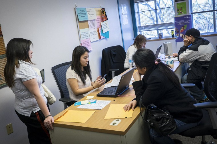 Healthcare navigators assist customers as they try to sign up for health insurance at The Montgomery County Department of Health and Human Services in Silver Spring Maryland on March 31.