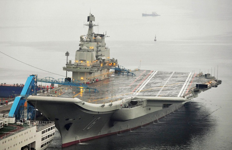Image: China's first aircraft carrier docked at Dalian Port, in Dalian, Liaoning province
