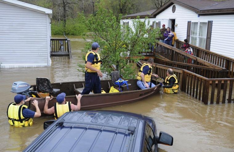 Girl Believed Swept Away as Floods Slam South