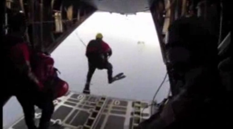 Image: Still image of a member of the California Air National Guard's 129th Rescue Wing jumping off a plane during a rescue mission