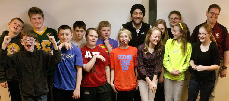 "The ""Math Minions,"" sixth-graders at Oak Grove Middle School in Fargo, North Dakota, pose with Motif Investing founder Hardeep Walia (center right rear) and math teacher Dave Carlson (right rear)."