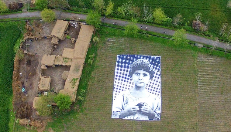 Image: A poster bearing the image of a Pakistani girl