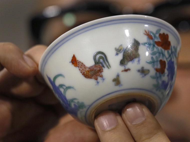 "The Meiyintang ""Chicken Cup"" from the Chinese Ming Dynasty (1368-1644) is displayed in Hong Kong, on Tuesday. Sotheby's said Shanghai collector Liu Yiqian won the bidding for the cup, which with  the auction house's commission, comes to $36.1 million, a world record for Chinese porcelain."