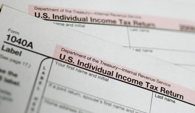 Image: U.S. 1040A Individual Income Tax form is seen at a U.S. Post office in New York