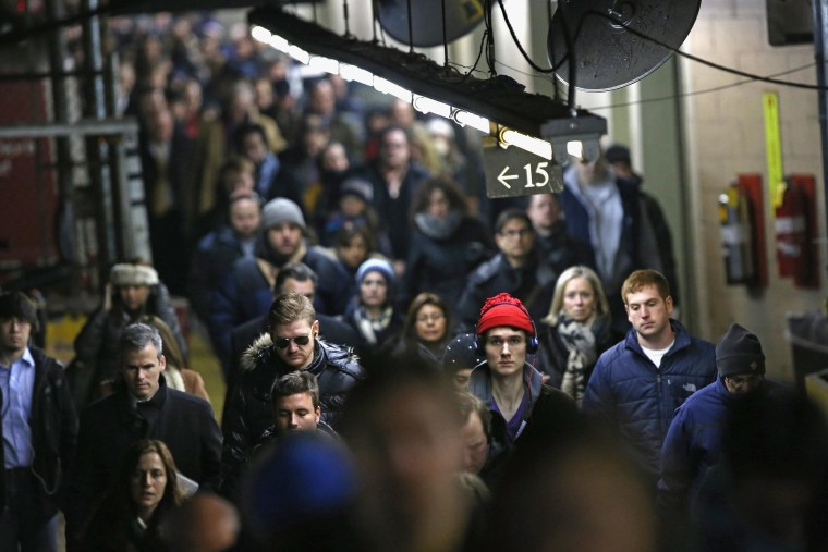 Image: Commuters arrive at Grand Central station from a Metro North train on Jan. 22 in New York City.
