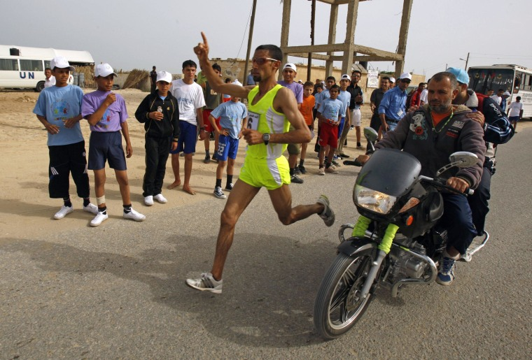 Image: Palestinian long-distance runner Masri takes part in a marathon in Rafah in the southern Gaza Strip