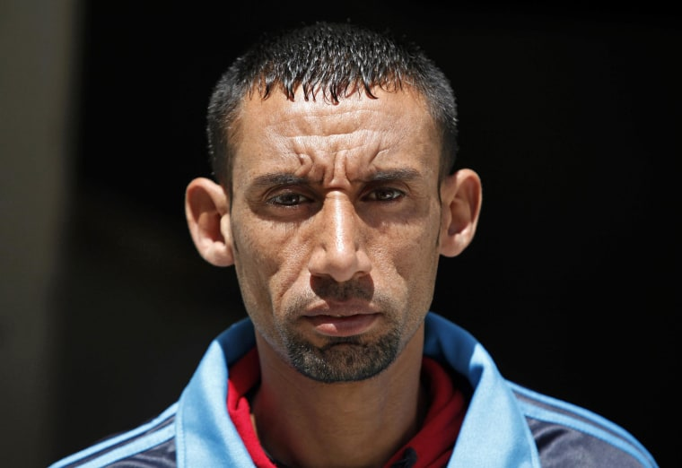 Nader Al-Masri poses at his home, in Beit Hanoun in the Gaza Strip on Tuesday. Israel's high court has upheld a decision by the military to prevent Masri from leaving the coastal strip to participate in a marathon in the West Bank.