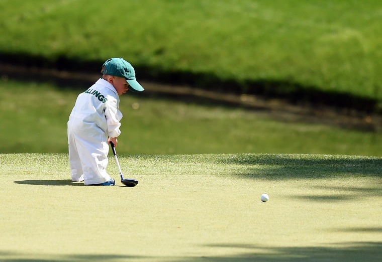 Image: Finn, son of Scott Stallings, plays during the Par 3 Contest at Augusta