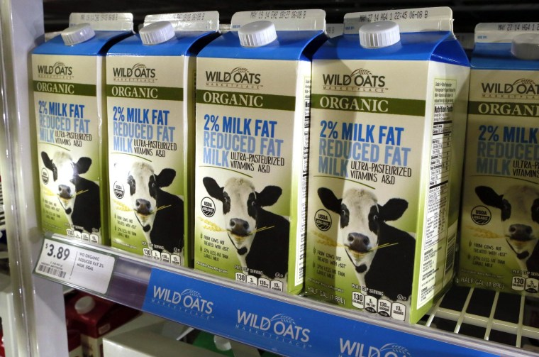 Cartons of milk produced by Wild Oats are seen in a Fresh & Easy store in Palm Springs, Calif.