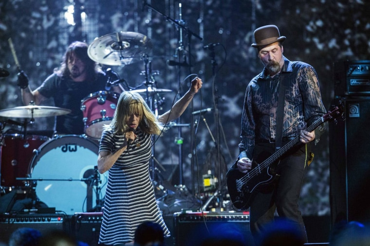 Image: Gordon of Sonic Youth performs with Grohl and Novoselic of Nirvan