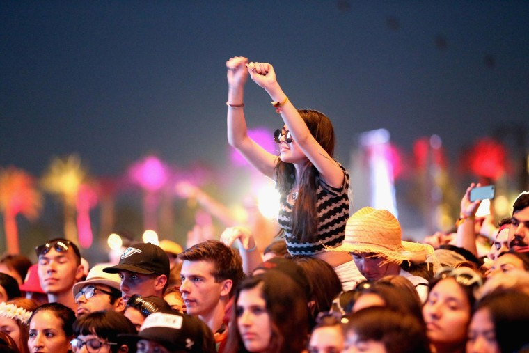 A fan watches Modest Mouse perform during day 1 of the 2013 Coachella Valley Music & Arts Festival - Weekend 2 at the Empire Polo Club on April 19, 2013 in Indio, Calif.